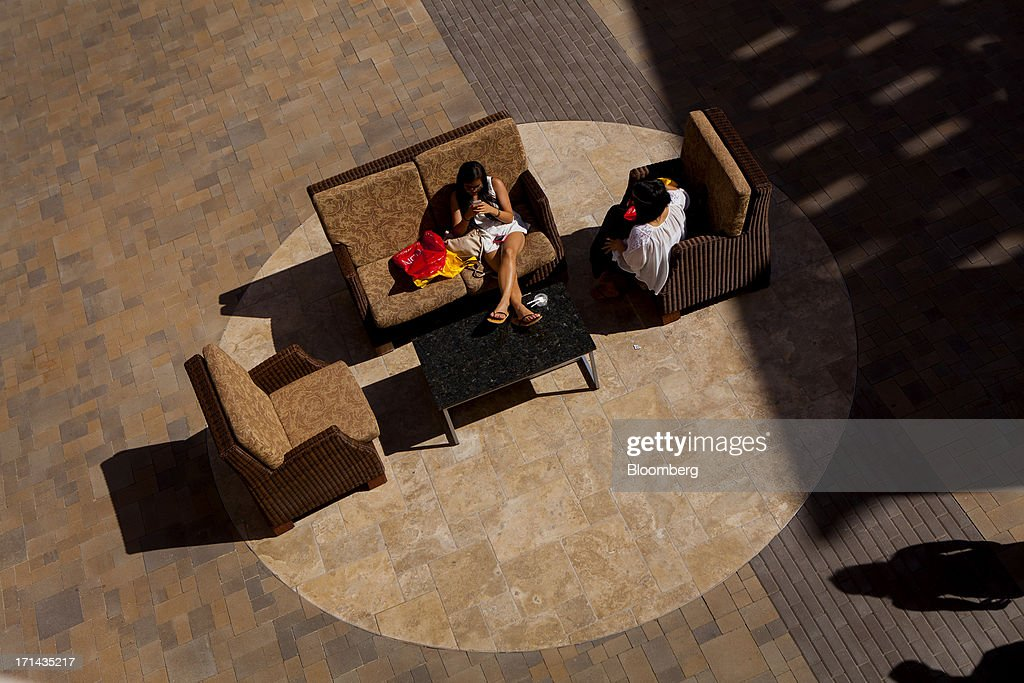 Shoppers talk while sitting on couches at the Fashion Valley Mall in San Diego, California, U.S., on Saturday, June 22, 2013. The Bureau of Economic Analysis is schedule to release personal consumption figures on June 26. Photographer: Sam Hodgson/Bloomberg via Getty Images