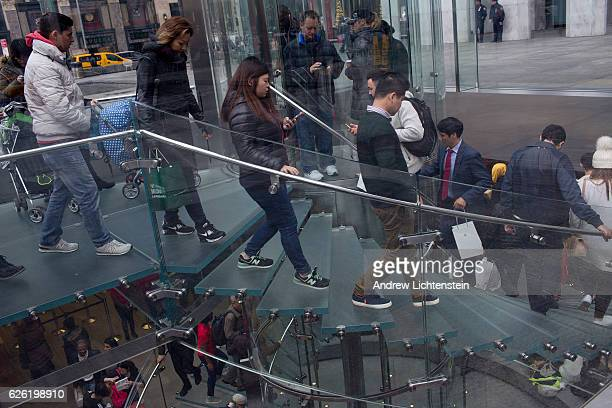 Shoppers tourists and the internationally wealthy shop and mingle amidst the high end luxury retail stores along Fifth Avenue in midtown Manhattan on...
