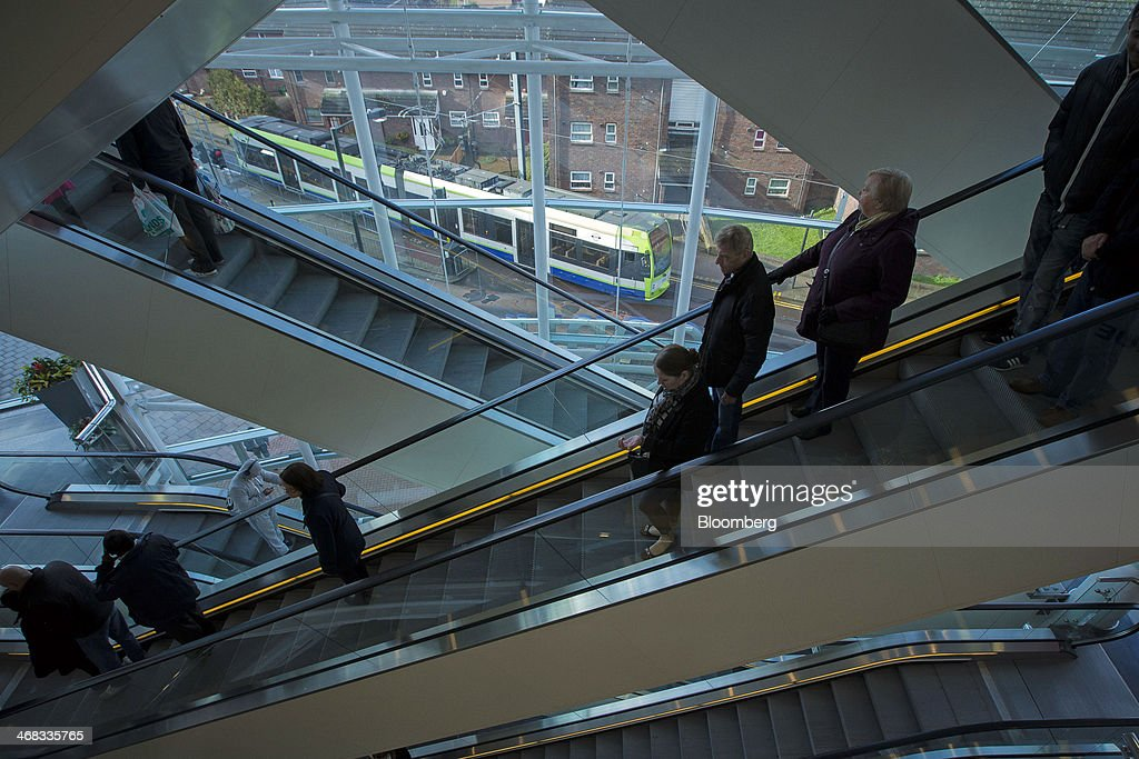 Shoppers travel on escalators inside the Centrale shopping mall, operated by Hammerson Plc, in Croydon, south London, U.K., on Monday, Feb. 10, 2014. Westfield Group, Australia's biggest mall operator, and Hammerson Plc won preliminary approval to rebuild the Whitgift Centre mall in south London as part of a project valued at about 1 billion pounds ($1.6 billion). Photographer: Jason Alden/Bloomberg via Getty Images