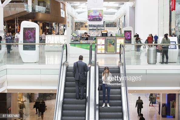 Shoppers travel on escalators inside the Westfield London shopping mall operated by Westfield Corp in London UK on Tuesday Feb 23 2016 The UK's...