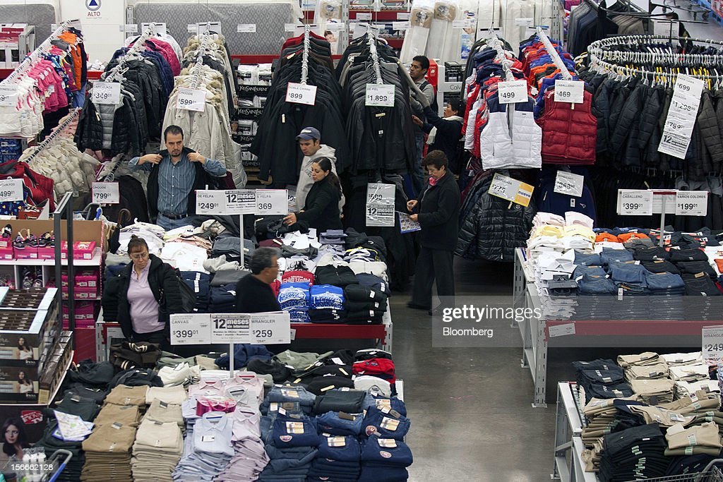 Shoppers try on merchandise inside a Sam's Club store in Mexico City, Mexico on Saturday, Nov. 17, 2012. El Buen Fin, Mexico's equivalent of Black Friday, when the year's biggest discounts are offered by participating stores, is held on the third weekend of November and will run through Nov. 19. Photographer: Susana Gonzalez/Bloomberg via Getty Images