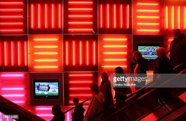 Shoppers use the escalator at Toys 'R' Us in Times Square November 23 2007 in New York City Black Friday the day after Thanksgiving is the first big...