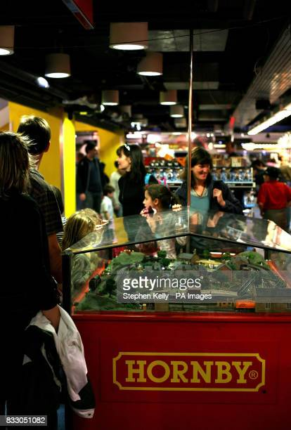 Shoppers view a Hornby train track in action in a toy shop in central London