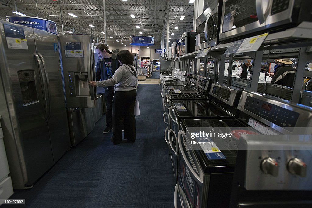 Shoppers view a refrigerator at a Best Buy Co. store in San Francisco, California, U.S. on Wednesday, Jan. 30, 2013. Consumer spending in the U.S. climbed in December as incomes grew by the most in eight years, a sign the biggest part of the economy was contributing to the expansion as the year drew to a close. Photographer: David Paul Morris/Bloomberg via Getty Images