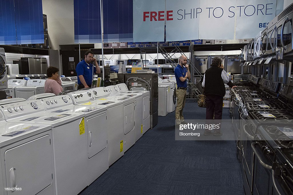 Shoppers view stoves and washing machines at a Best Buy Co. store in San Francisco, California, U.S. on Wednesday, Jan. 30, 2013. Consumer spending in the U.S. climbed in December as incomes grew by the most in eight years, a sign the biggest part of the economy was contributing to the expansion as the year drew to a close. Photographer: David Paul Morris/Bloomberg via Getty Images