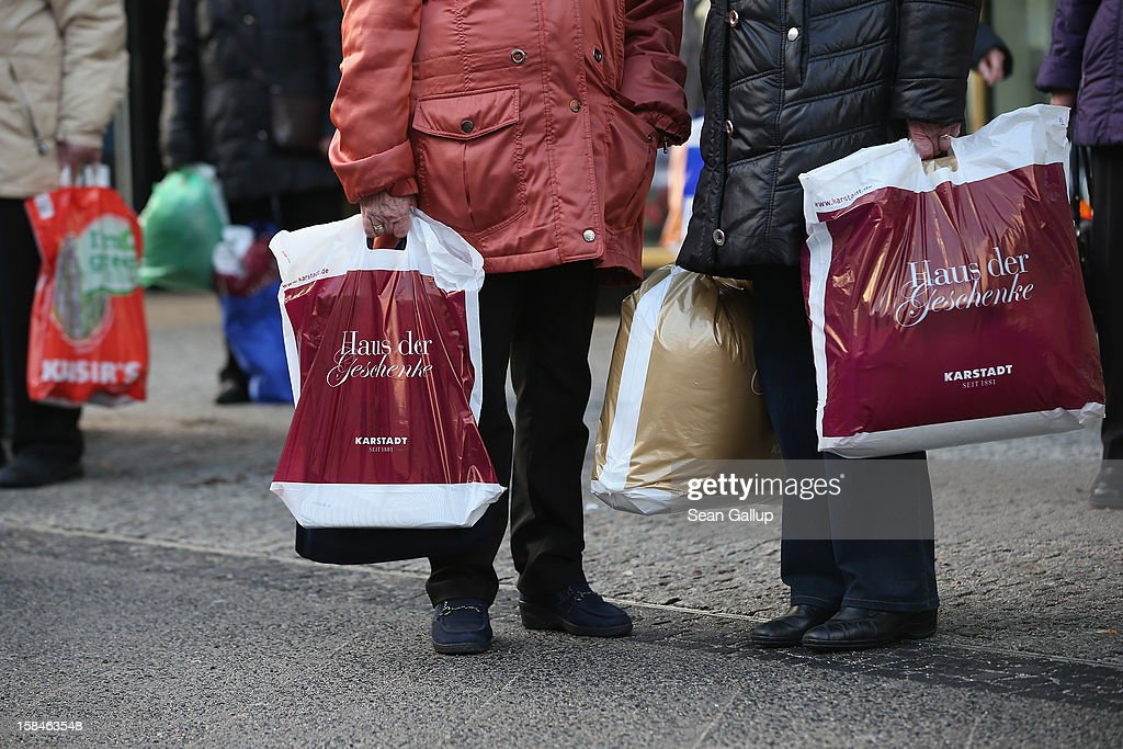Shoppers wait for a bus on a shopping street in Steglitz district on December 17, 2012 in Berlin, Germany. Retailers are hoping for a strong Christmas season in Germany, one of the few countries whose economy has so far weathered the current Eurozone debt crisis relatively well.
