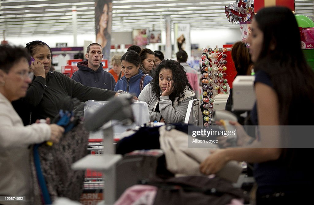 Shoppers wait in a check out line at a Kmart store during the Black Friday sales on November 23, 2012 in Braintree, Massachusetts. Black Friday, the start of the holiday shopping season, has traditionally been the busiest shopping day in the United States.