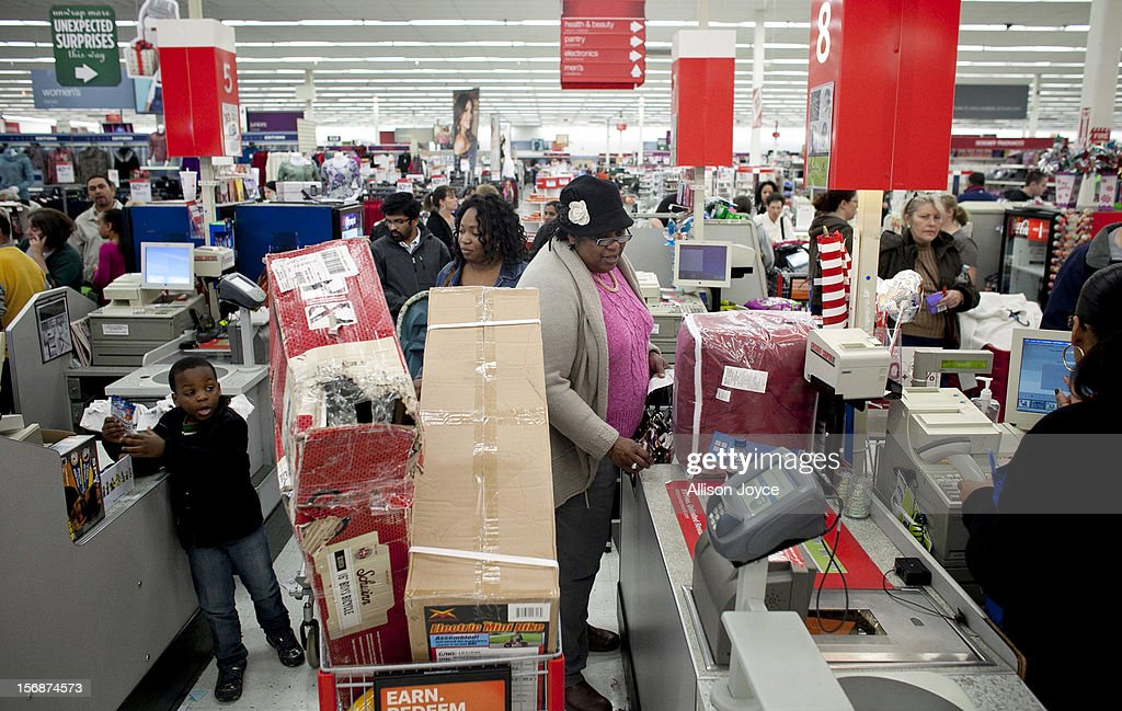 Shoppers wait in a check out line at Kmart during the Black Friday sales on November 23, 2012 in Braintree, Massachusetts. Black Friday, the start of the holiday shopping season, has traditionally been the busiest shopping day in the United States.