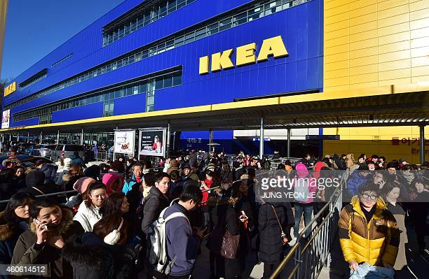 Shoppers wait in a long queue outside a store of Ikea in Gwangmyeong south of Seoul on December 18 2014 Global furniture giant Ikea opened its first...