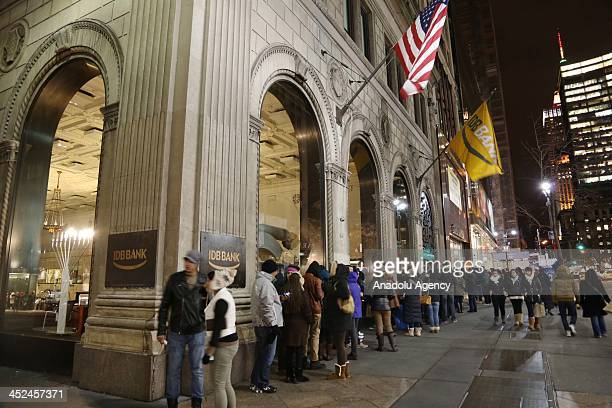 Shoppers wait in front of stores opening their doors for Black Friday sales price cuts reach to 70 percent on Thanksgiving Day this year on November...