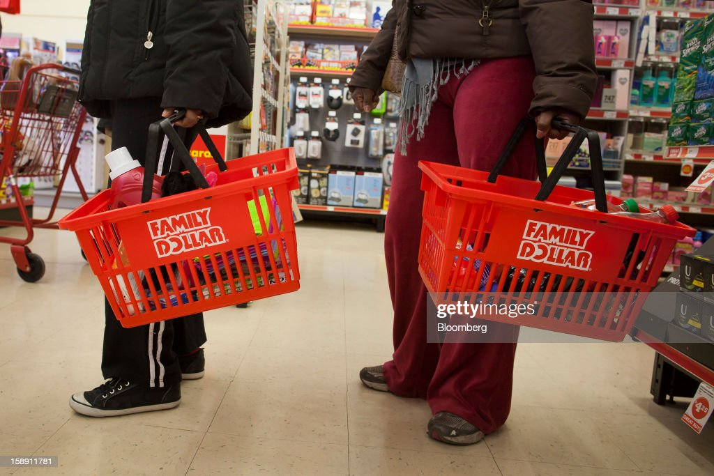 Shoppers wait in line at a Family Dollar Stores Inc. store in Belleville, New Jersey, U.S., on Thursday, Jan. 3, 2013. Family Dollar Stores Inc., the second-largest U.S. dollar store chain, tumbled the most in more than 12 years after cutting its fiscal 2013 earnings forecast, saying consumers are reluctant to spend on more-profitable discretionary items. Photographer: Michael Nagle/Bloomberg via Getty Images