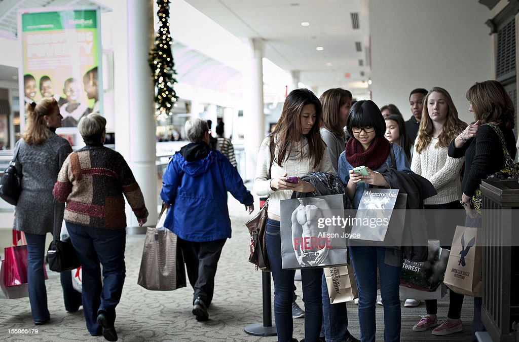 Shoppers wait in line outside of a Hollister store during Black Friday sales at the South Shore Plaza on November 23, 2012 in Braintree, Massachusetts. Black Friday, the start of the holiday shopping season, has traditionally been the busiest shopping day in the United States.