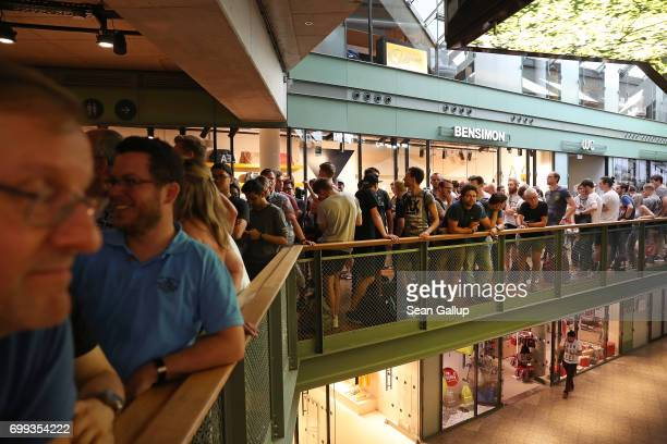 Shoppers wait in line to buy the new OnePlus 5 smartphone outside a OnePlus popup store at the Bikini Berlin shopping mall on June 21 2017 in Berlin...