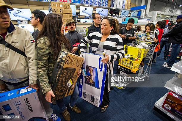 Shoppers wait in line to purchase television sets and other merchandise at a Best Buy Co store ahead of Black Friday in San Francisco California US...