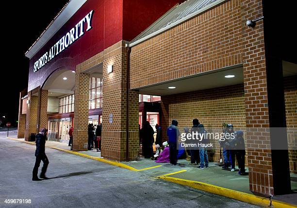 Shoppers wait in temperatures in the mid teens as they wait to get their holiday shopping season going at the annual Black Friday sales event at the...