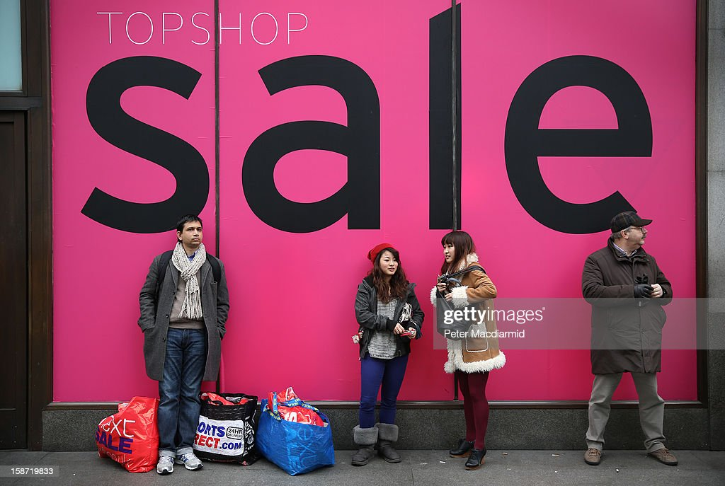 Shoppers wait outside Topshop on Oxford Circus on December 26, 2012 in London, England. Thousands of shoppers are in London looking for a bargain in the traditional Boxing Day sales.
