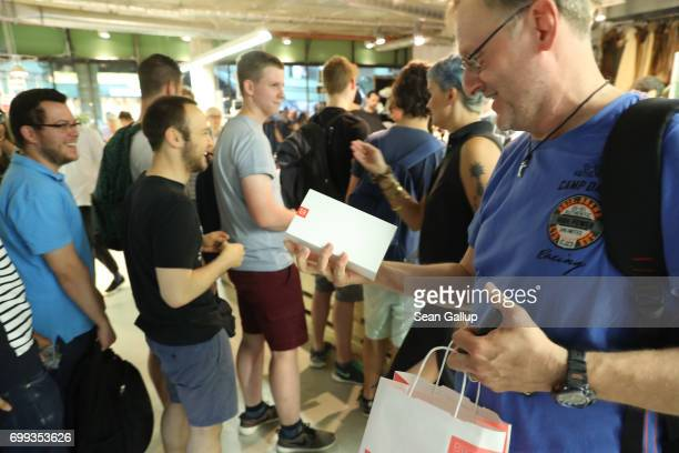Shoppers wait to buy the new OnePlus 5 smartphone at a OnePlus popup store at the Bikini Berlin shopping mall on June 21 2017 in Berlin Germany...
