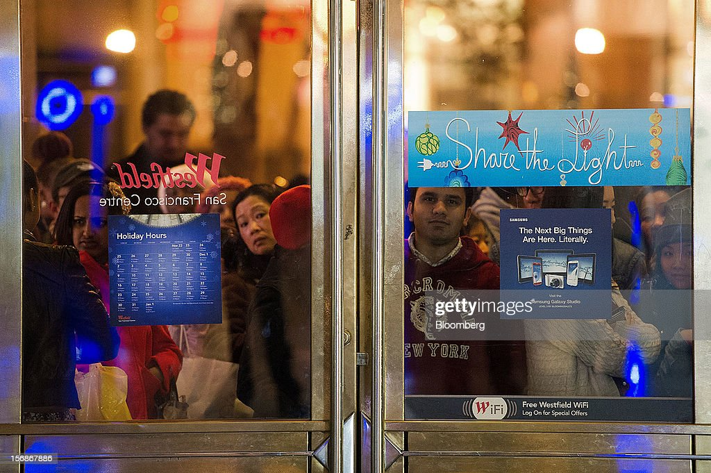 Shoppers wait to enter the Westfield San Francisco Centre mall in San Francisco, California, U.S., on Friday, Nov. 23, 2012. To get shoppers to spend more than last year, retailers have continued to turn Black Friday, originally a one-day event after Thanksgiving, into a week's worth of deals and discounts. Photographer: David Paul Morris/Bloomberg via Getty Images