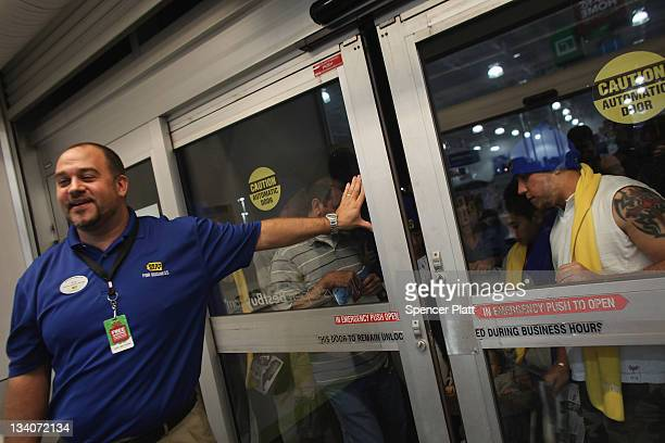 Shoppers wait to get inside of a Best Buy store on November 25 2011 in Naples Florida Although controversial many big retail stores decided to get a...