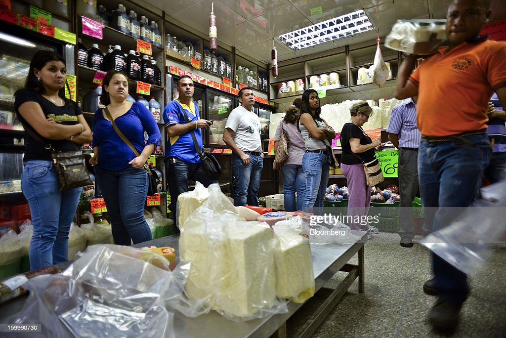 Shoppers waited in line to buy food at a private sector grocery store in the Quinta Crespo market in central Caracas, Venezuela, on Monday, Jan. 14, 2013. The government is conducting a nationwide campaign to crack down on over-pricing and hoarding it blames for shortages of basic goods, from toilet paper to sugar. Photographer: Meridith Kohut/Bloomberg via Getty Images