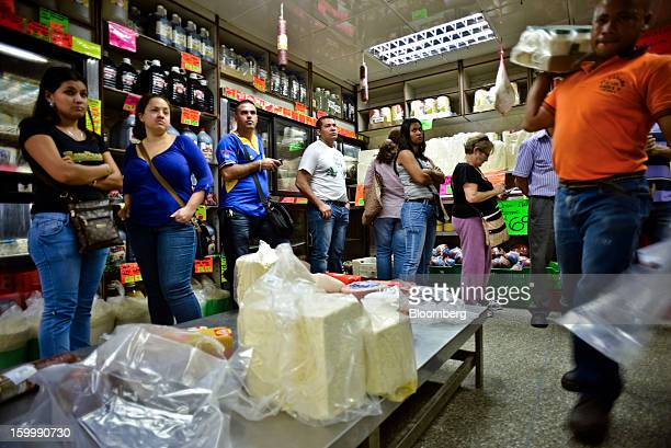 Shoppers waited in line to buy food at a private sector grocery store in the Quinta Crespo market in central Caracas Venezuela on Monday Jan 14 2013...