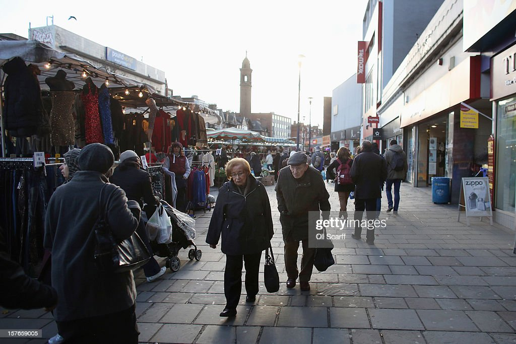 Shoppers walk along Lewisham high street on December 5, 2012 in London, England. The Chancellor of the Exchequer George Osborne has stated that the United Kingdom's economy is still struggling during his autumn budget statement to Parliament.