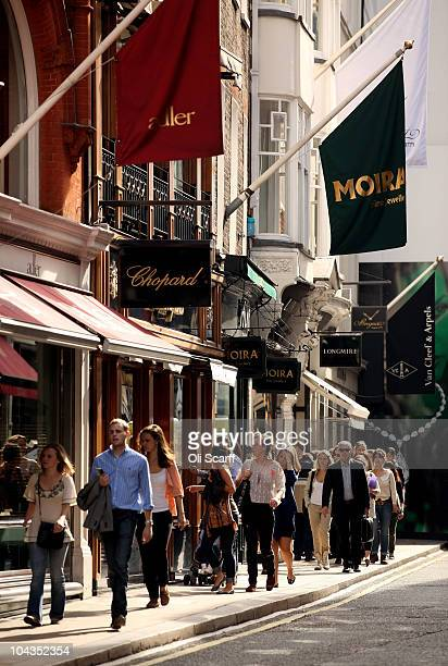 Shoppers walk along New Bond Street in Mayfair which is the most expensive avenue in Europe for retail rents on September 22 2010 in London England...