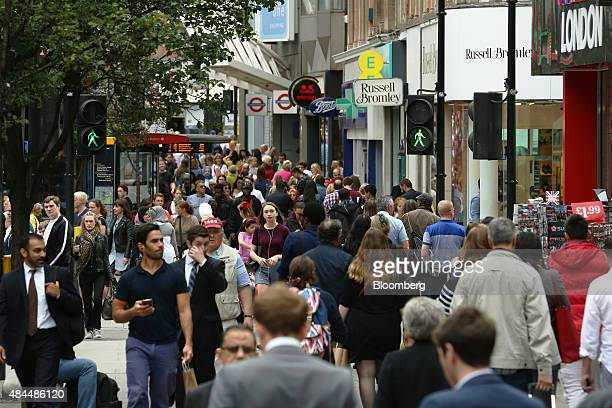 Shoppers walk along Oxford Street in London UK on Wednesday Aug 19 2015 The pound reached a sevenweek high against the dollar Tuesday after data...
