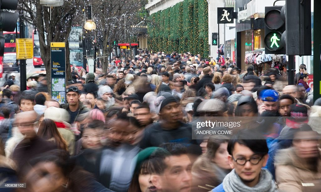 Shoppers walk along Oxford Street to find bargains in central London on December 26 in the post Christmas Boxing Day sales AFP PHOTO / ANDREW COWIE