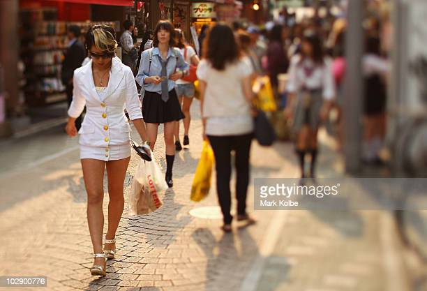 Shoppers walk along Takeshita Street in Harajuku on May 25 2010 in Tokyo Japan Takeshita Street is pedestrianonly shopping strip popular amongst...