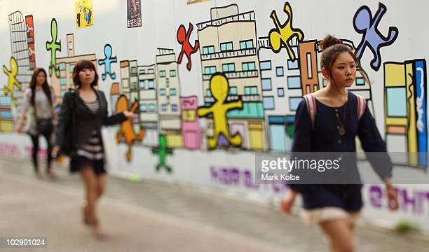 Shoppers walk along Takeshita Street in Harajuku on May 25 2010 in Tokyo Japan Takeshita Street is pedestrianonly shopping strip popular amongst...
