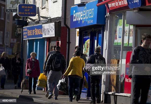 Shoppers walk along the high street in the market town of Boston in Lincolnshire on March 5 2015 For centuries the town of Boston in eastern England...