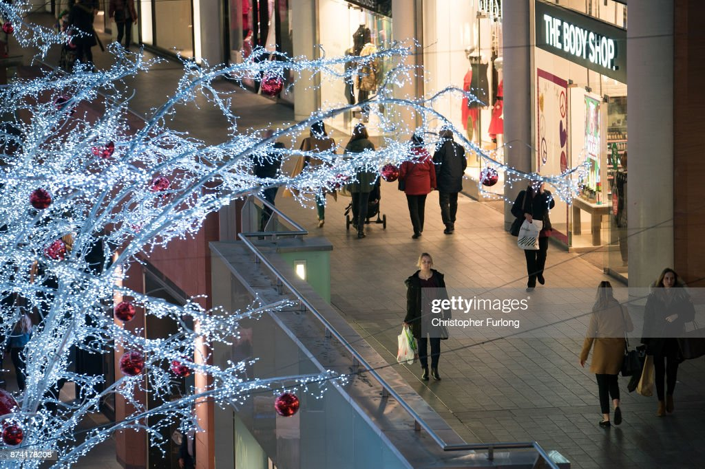 Shoppers walk among the Christmas lights as shops and businesses in Liverpool hope of an early boost to sales during the festive period on November 14, 2017 in Liverpool, England.
