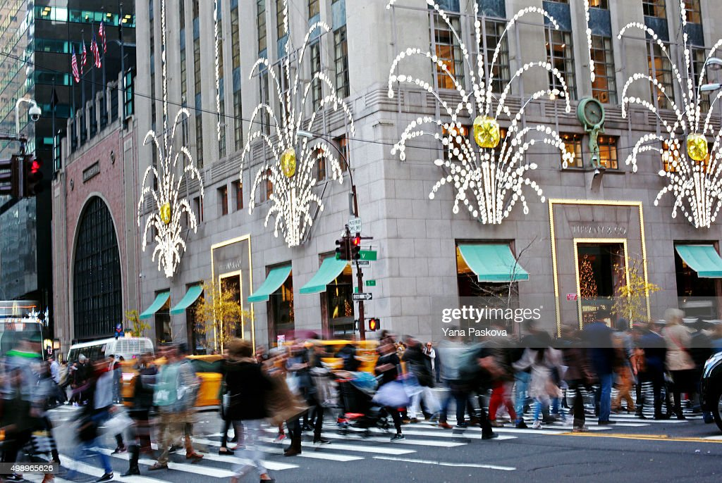 Shoppers walk by holiday decor hanging on Tiffany Co in New York City on Black Friday November 27 2015 Although Black Friday sales are expected to be...