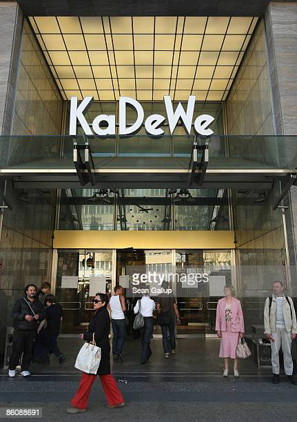 Shoppers walk by the KaDeWe luxury department store on April 21 2009 in Berlin Germany German retail group Arcandor AG which owns KaDeWe as well as...