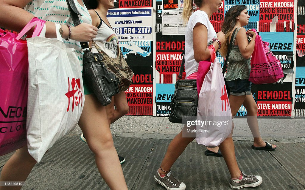 Shoppers walk down Broadway in Manhattan on July 16 2012 in New York City Retail sales declined for a third straight month as the US economic...