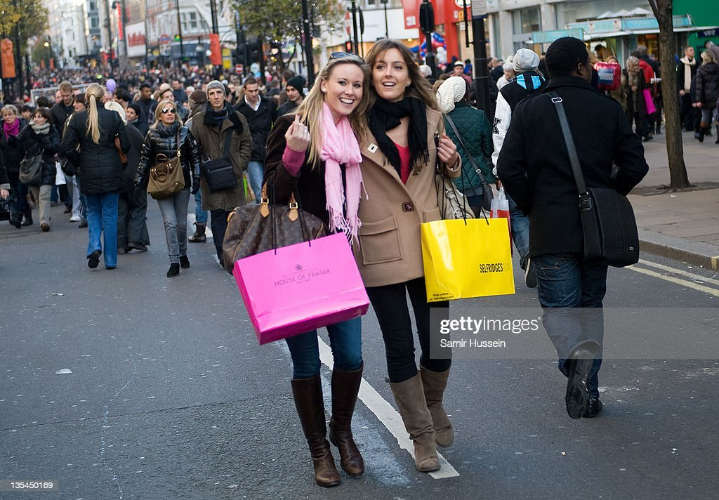 Shoppers walk down Oxford Street during American Express Shop West End VIP Weekend on DECEMBER 10, 2011 in London, England. West End stores predict £180m sales today with 1m shoppers spending on fashions and gifts. Over 50,000 'early bird' shoppers were out in London's West End by 8.30am this morning for a bumper Christmas shopping day, as the West End removed all traffic on Oxford Street and Regent Street to make way for festive shoppers for the 7th American Express Annual Shop West End VIP (Very Important Pedestrian) Weekend.