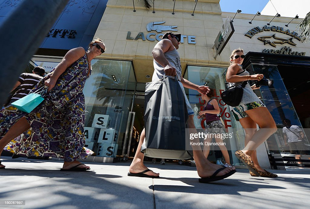 Shoppers walk in front of store on Rodeo Drive August 14 2012 in Beverly Hills California Consumer spending rebounded as monthly retail sales rose in...