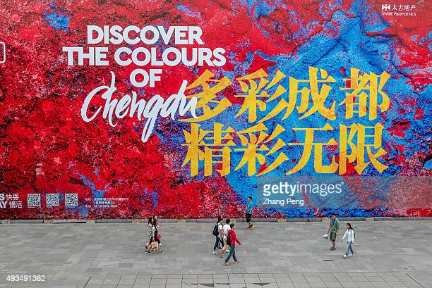 Shoppers walk in front of the huge billboard of Chengdu Tai Koo Li On Oct7 SinoOcean Taikoo Li Chengdu a 100000 sqm openplan lanedriven retail...