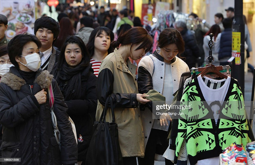 Shoppers walk in the Myungdong shopping district on April 11, 2013 in Seoul, South Korea. According to reports a North Korean missile launcher has been moved into firing position as the continuing threats of attack emit from Pyongyang. G8 leaders have convened in London to discuss the situation.