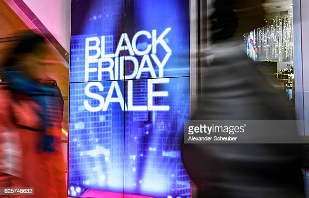 Shoppers walk inside a Macy's store during Black Friday events on November 25 2016 in New York City The day after Thanksgiving called Black Friday is...