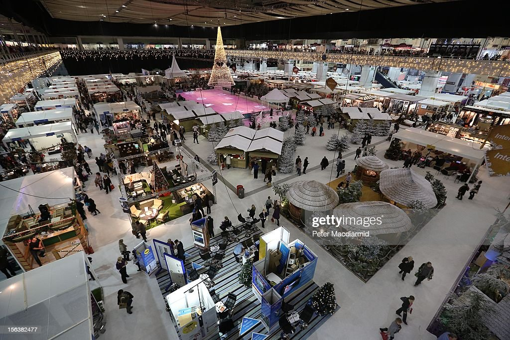 Shoppers walk on a snow like carpet as they visit The Ideal Home Christmas Show on November 14, 2012 in London, England. Over 400 exhibitors are showcasing a range of gift ideas for Christmas at the Earls Court exhibition centre.