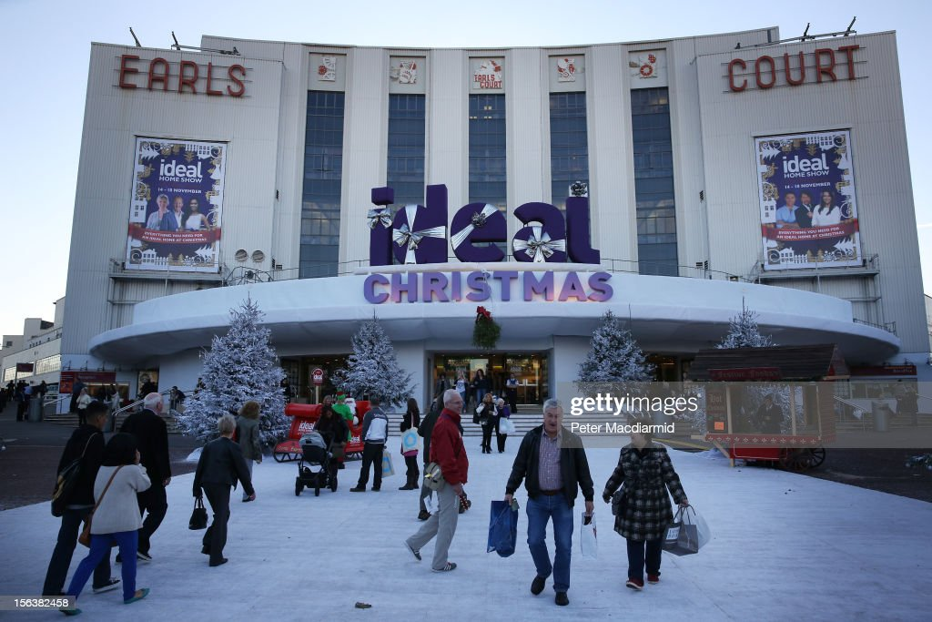 Shoppers walk on a white snow like carpet in front of The Ideal Home Christmas Show on November 14, 2012 in London, England. Over 400 exhibitors are showcasing a range of gift ideas for Christmas at the Earls Court exhibition centre.