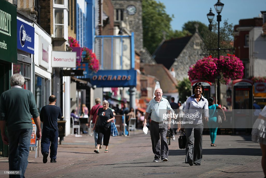 Shoppers walk on the High Street on September 2, 2013 in Dartford, England. High Street campaigner Mary Portas is today facing questions from Members of Parliament on the communities and local government select committee. The traditional high street is under increasing pressure due to the recession and the rise of on-line shopping.