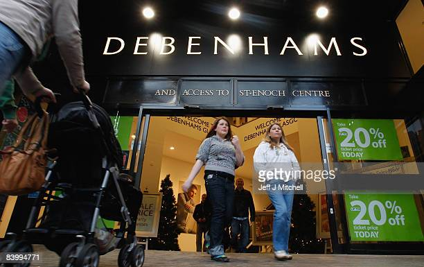 Shoppers walk out from the St Enoch branch of Debenhams on December 11 2008 in Glasgow Scotland The store is just one of many shops holding a 20...