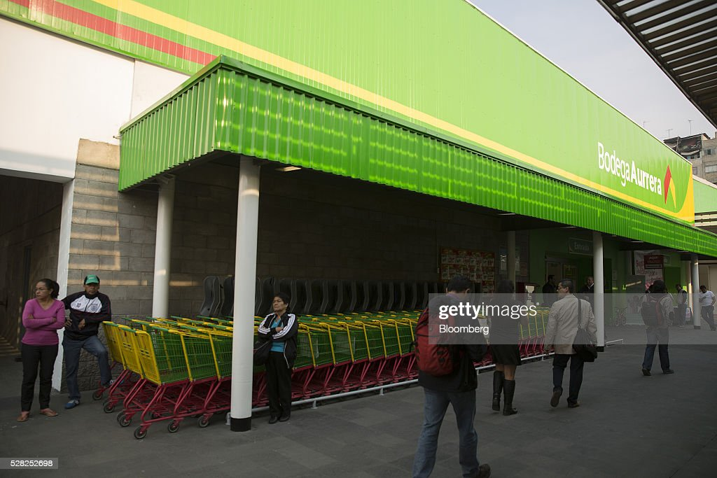 Shoppers walk outside a Bodega Aurrera store, the discount chain owned by Wal-Mart Stores Inc., in Naucalpan de Juarez, Mexico, on Wednesday, May 4, 2016. Wal-Mart de Mexico SAB reported first-quarter results last week that beat analysts estimates, the most recent sign of growth for Mexican companies this earnings season. Photographer: Susana Gonzalez/Bloomberg via Getty Images