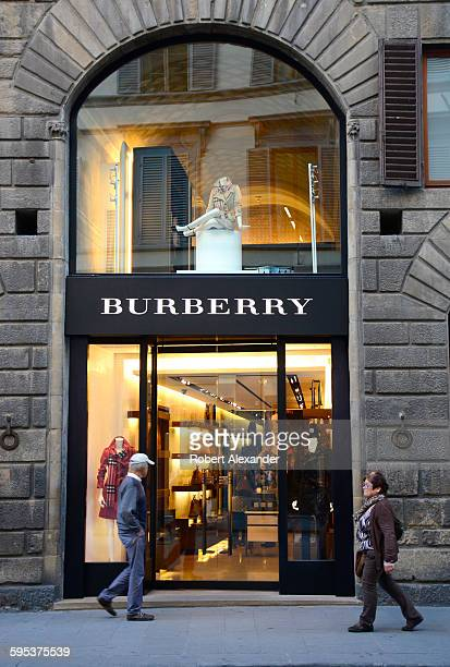 Shoppers walk past a Burberry clothing store in Florence Italy The iconic British luxury brand was established in 1856
