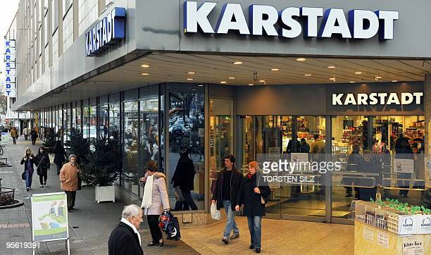 Shoppers walk past a department store of troubled German retailer Karstadt in the central German city of Hanau on December 1 2009 Karstadt will have...