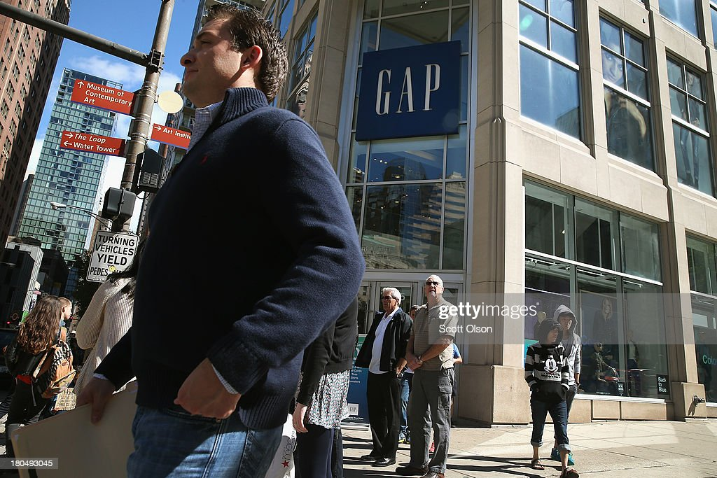 Shoppers walk past a GAP store along the Magnificent Mile shopping district on September 13, 2013 in Chicago, Illinois. According to the Commerce Department retail sales rose a seasonally adjusted 0.2 percent in August from the previous month, short of the 0.5 percent anticipated by economists.