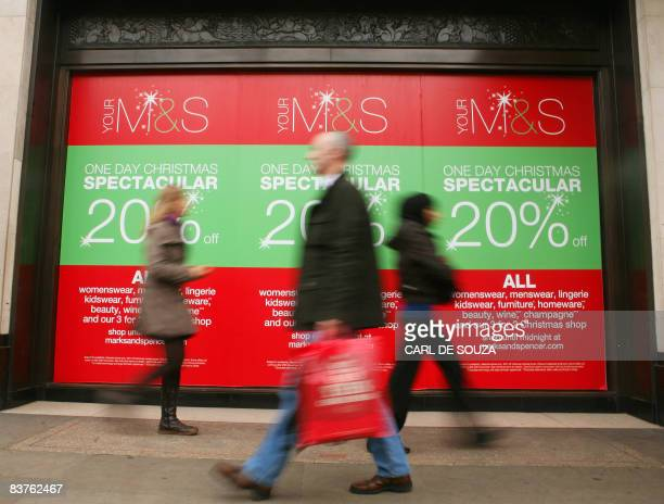 Shoppers walk past a Marks and Spencer store in central London on November 20 2008 Marks and Spencer are holding a preChristmas one day sale with 20%...